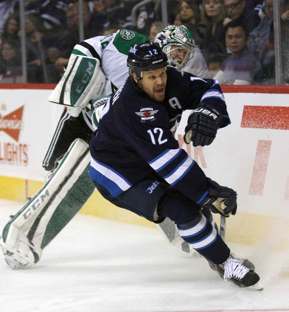 Olli Jokinen gets tied up with Dallas Stars goaltender Kari Lehtonen during the second period. (JOE BRYKSA / WINNIPEG FREE PRESS)