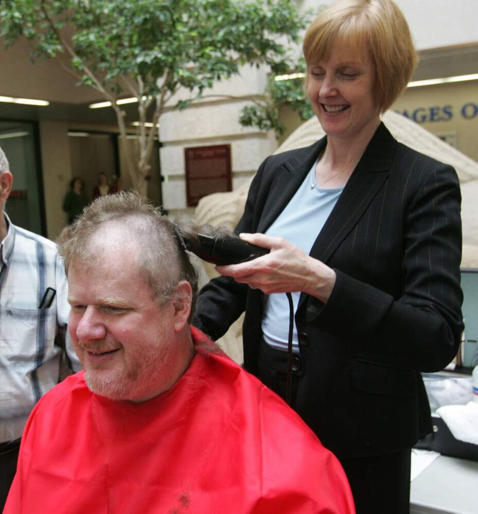 Lindor shaves the head of columnist Doug Speirs. Doug and seven other colleagues got their heads  shaved to raise over $2,000 for the Cancer Care Manitoba Foundation in 2009, in support of photo editor Jon Thordarson who was battling cancer. (Wayne Glowacki/Winnipeg Free Press)