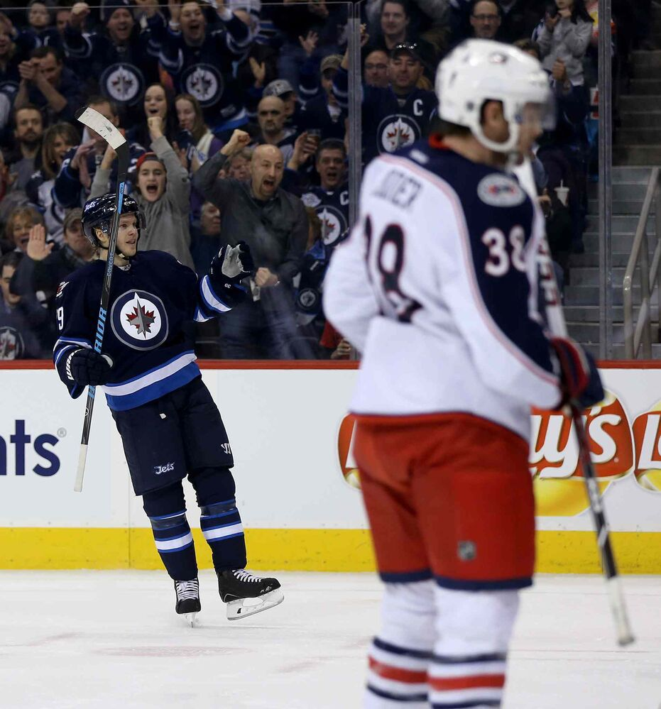 Winnipeg Jets' Tobias Enstrom (39) celebrates his second-period goal against the Columbus Blue Jackets. (Trevor Hagan / Winnipeg Free Press)