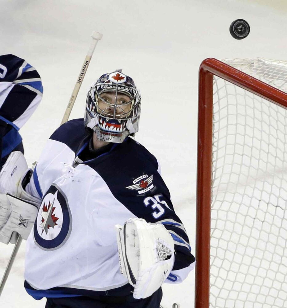 Winnipeg Jets goalie Al Montoya deflects a San Jose Sharks shot during the first period.  (Marcio Jose Sanchez / The Associated Press)