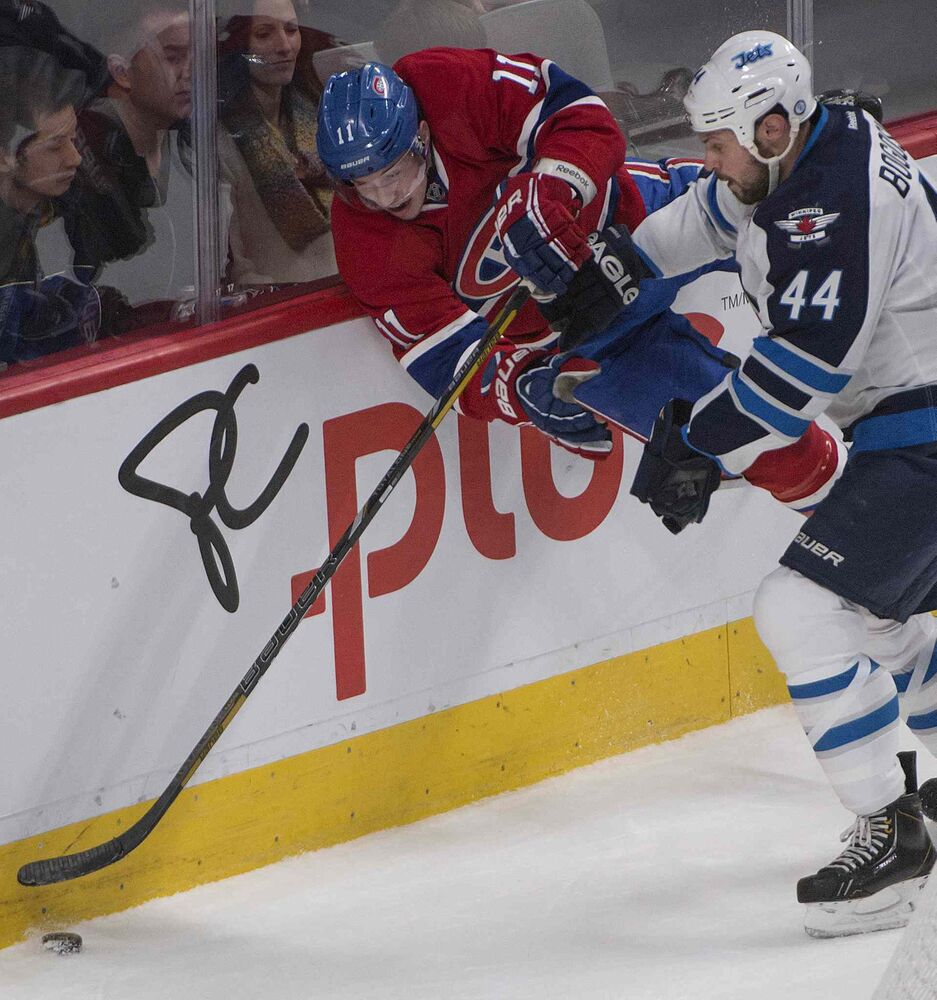Jets defenseman Zach Bogosian teaches  Habs Brendan Gallaghera lesson. (Peter McCabe / The Canadian Press)