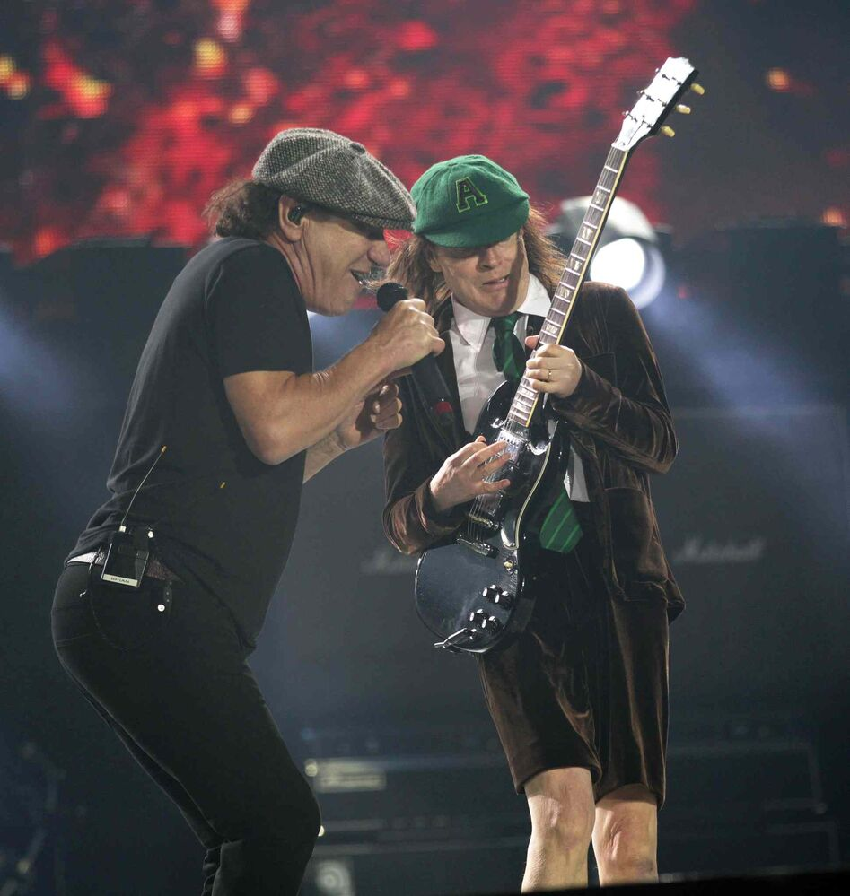 Brian Johnson and Angus Young (right) at the Investor's Group Field in Winnipeg Thursday.  September 17, 2015 - (Phil Hossack / Winnipeg Free Press)