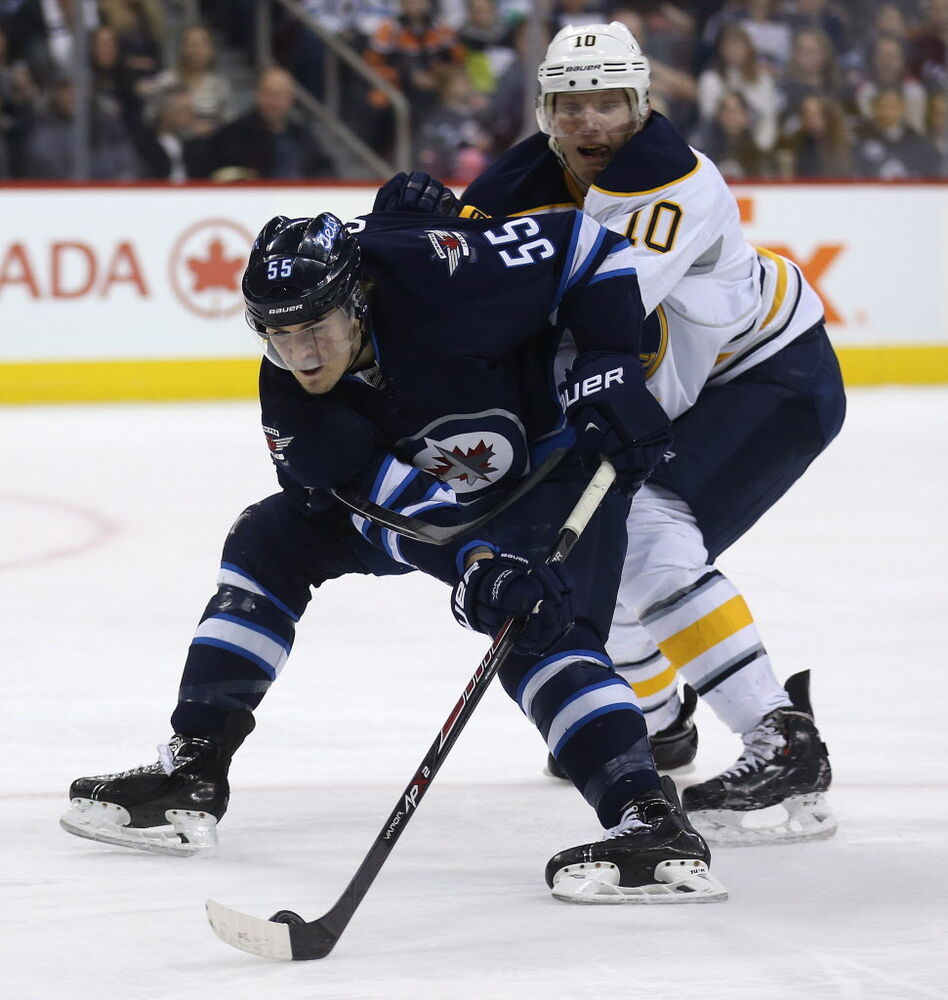 Winnipeg Jets' Mark Scheifele (#55) works his way around Buffalo Sabres' Christian Ehrhoff (#10) during the game's second period in Winnipeg Tuesday.