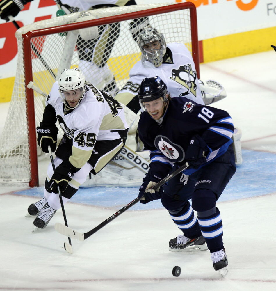 Pittsburgh Penquin Brian Gibbons (49) looks to take the rebound away from Winnipeg's Bryan Little in front of netminder Marc-Andre Fleury Thursday. (Phil Hossack / Winnipeg Free Press)