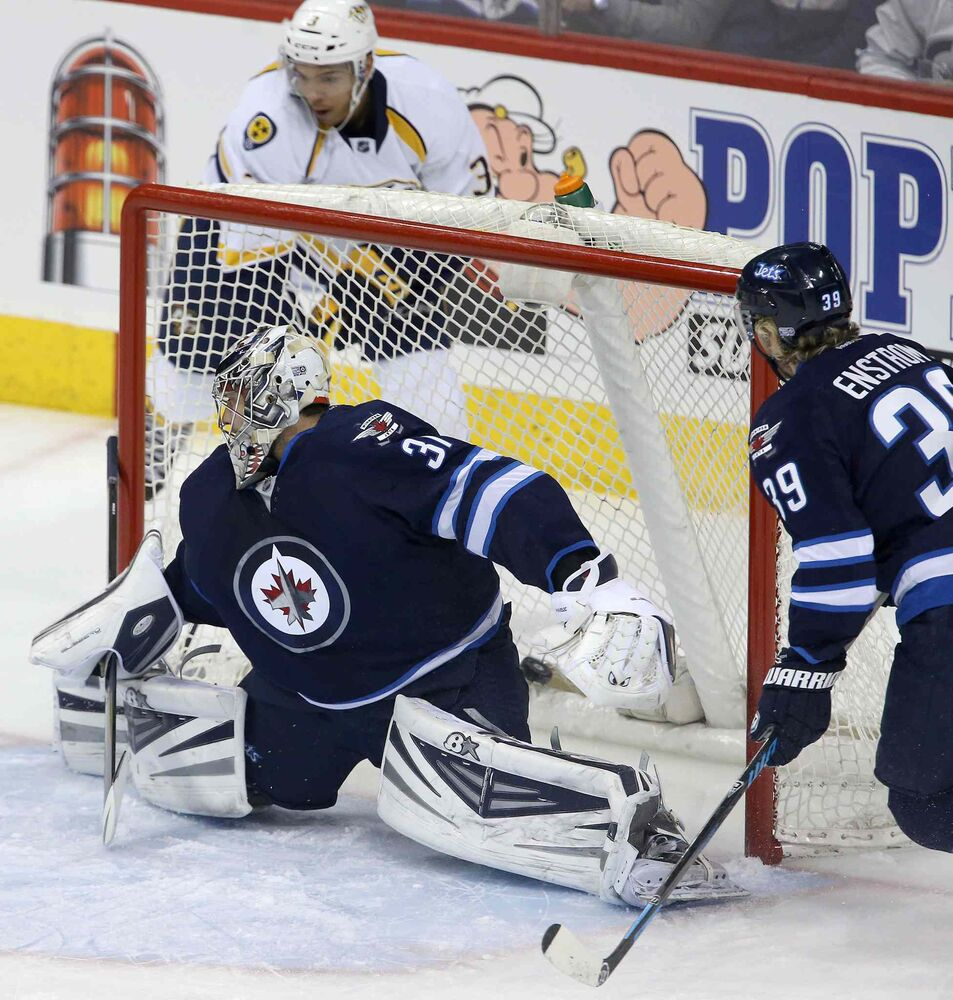 The puck sits in the back of the net after Nashville Predators' Seth Jones (3) scores with a wrap-around on Winnipeg Jets' goaltender Ondrej Pavelec (31) during first period of Tuesday's game in Winnipeg.