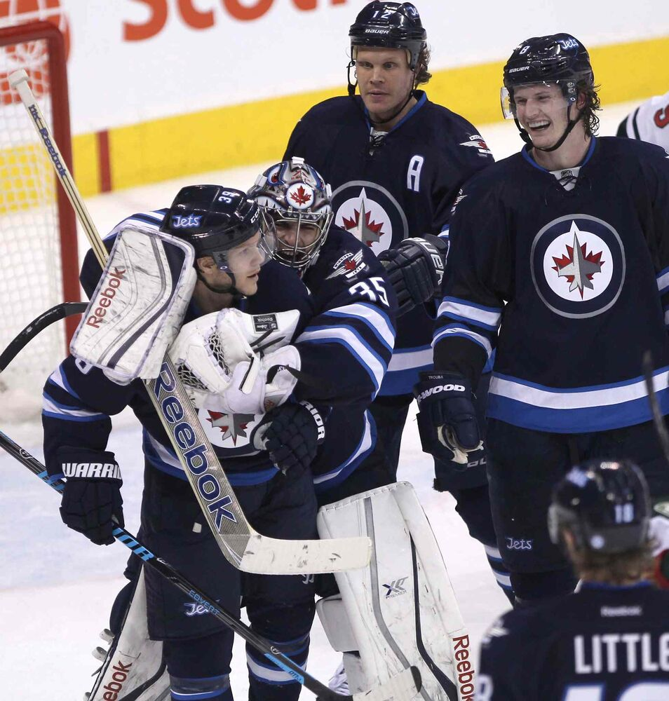 Winnipeg Jets goaltender Al Montoya (centre left) hugs teammate Tobias Endstrom as Olli Jokinen (top), Jacob Trouba (right) and Bryan Little (bottom) look on after beating the Minnesota Wild 6-4 Friday night. (JOE BRYKSA / WINNIPEG FREE PRESS)