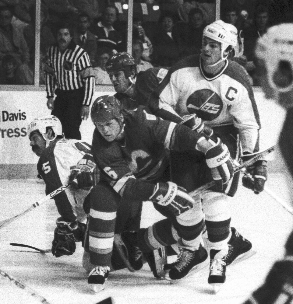 Hawerchuk and Paul MacLean battle against their bitter rivals, the Calgary Flames, on Oct. 24, 1986. (Wayne Glowacki / Winnipeg Free Press files) -