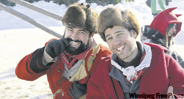 Ruth Bonneville / Winnipeg Free Press Ultimate Voyageur contest winners Francisco Munilla (left) and Eric Toupin-Selinger test their gold medals.