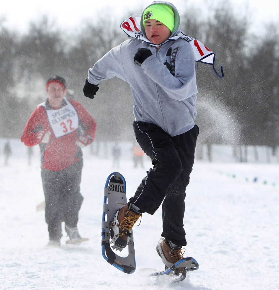 Gabriel Mayham leaves his opponents in the dust as he races down the snow-packed 100-metre snowshoe course in the field at St. John's Ravenscourt while competing in the 34th Annual Kinsmen Winnipeg WInter Games.  (Ruth Bonneville / Winnipeg Free Press  )