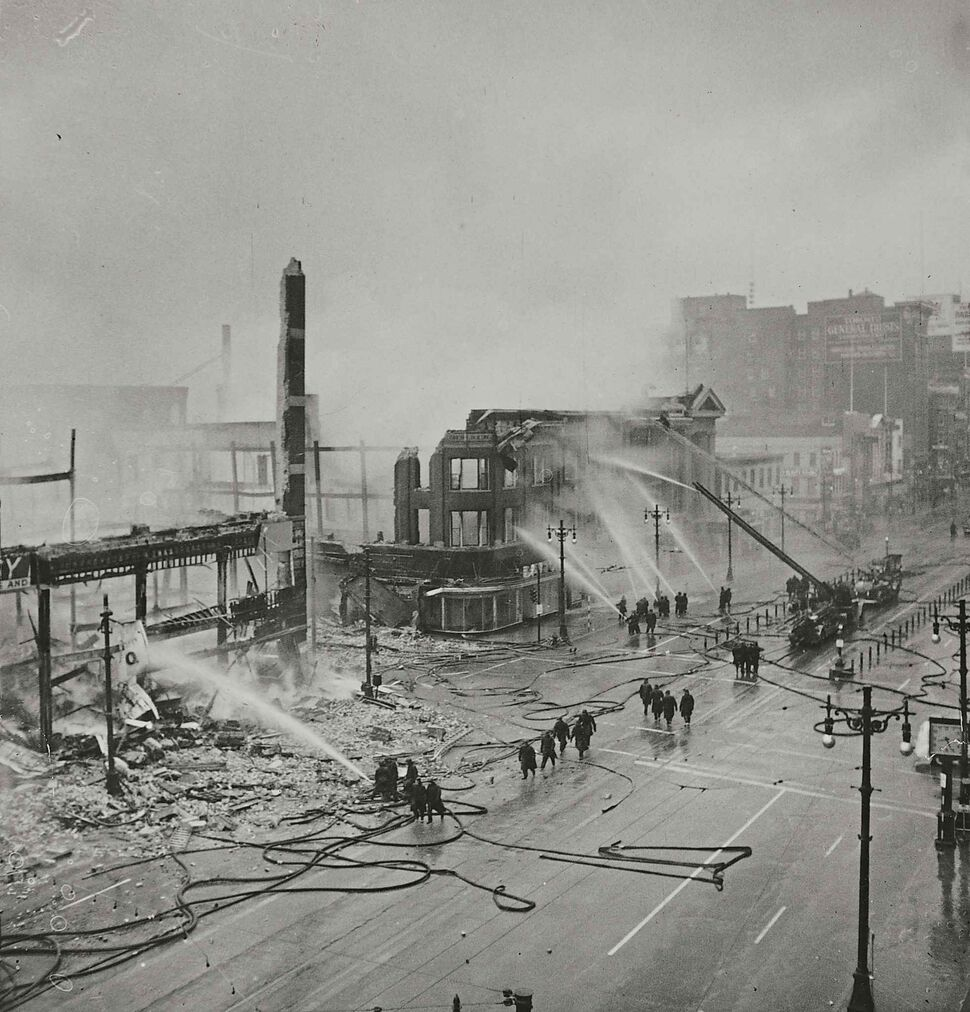 WINNIPEG FREE PRESS FILES</p><p>Firefighters hose down the smouldering remains of the Time Building (left) and Dismorr Block. </p>