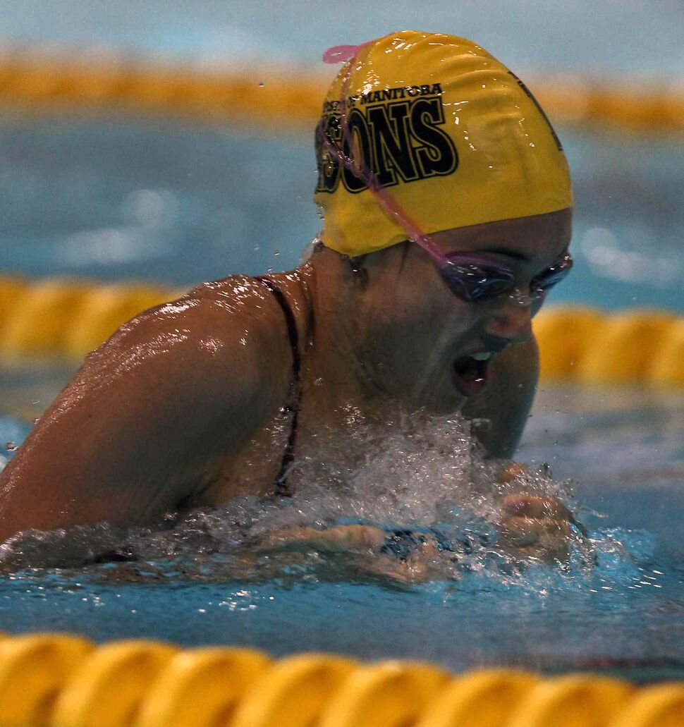 Kelsey Wog of the University of Manitoba Bisons swim club swims for gold in the 15 year old girls 100m breaststroke at the 2014 Canadian Age Group Championships at Pan Am Pool in Winnipeg. (JOE BRYKSA / WINNIPEG FREE PRESS)