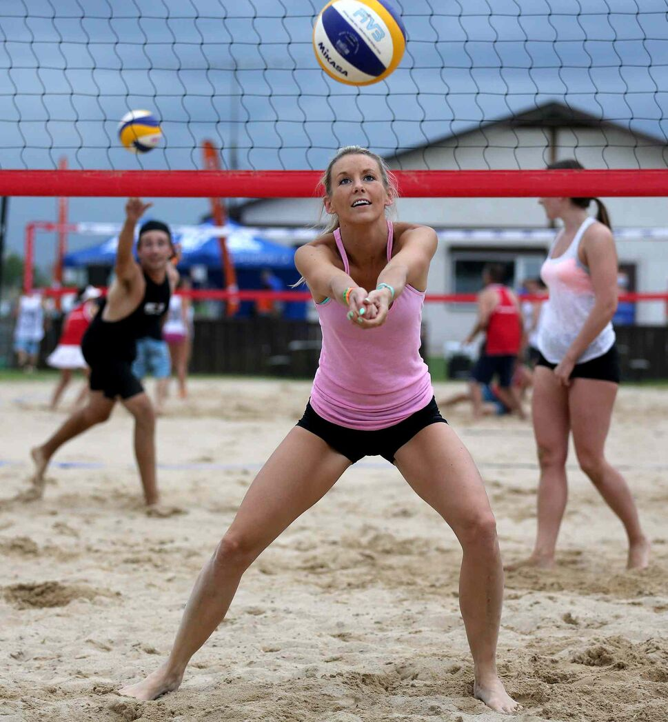 Brittany Balcewich of City Kitties warms up at the Super-Spike volleyball tournament at Maple Grove Rugby Park, Friday, July 18, 2014.  (TREVOR HAGAN/WINNIPEG FREE PRESS)