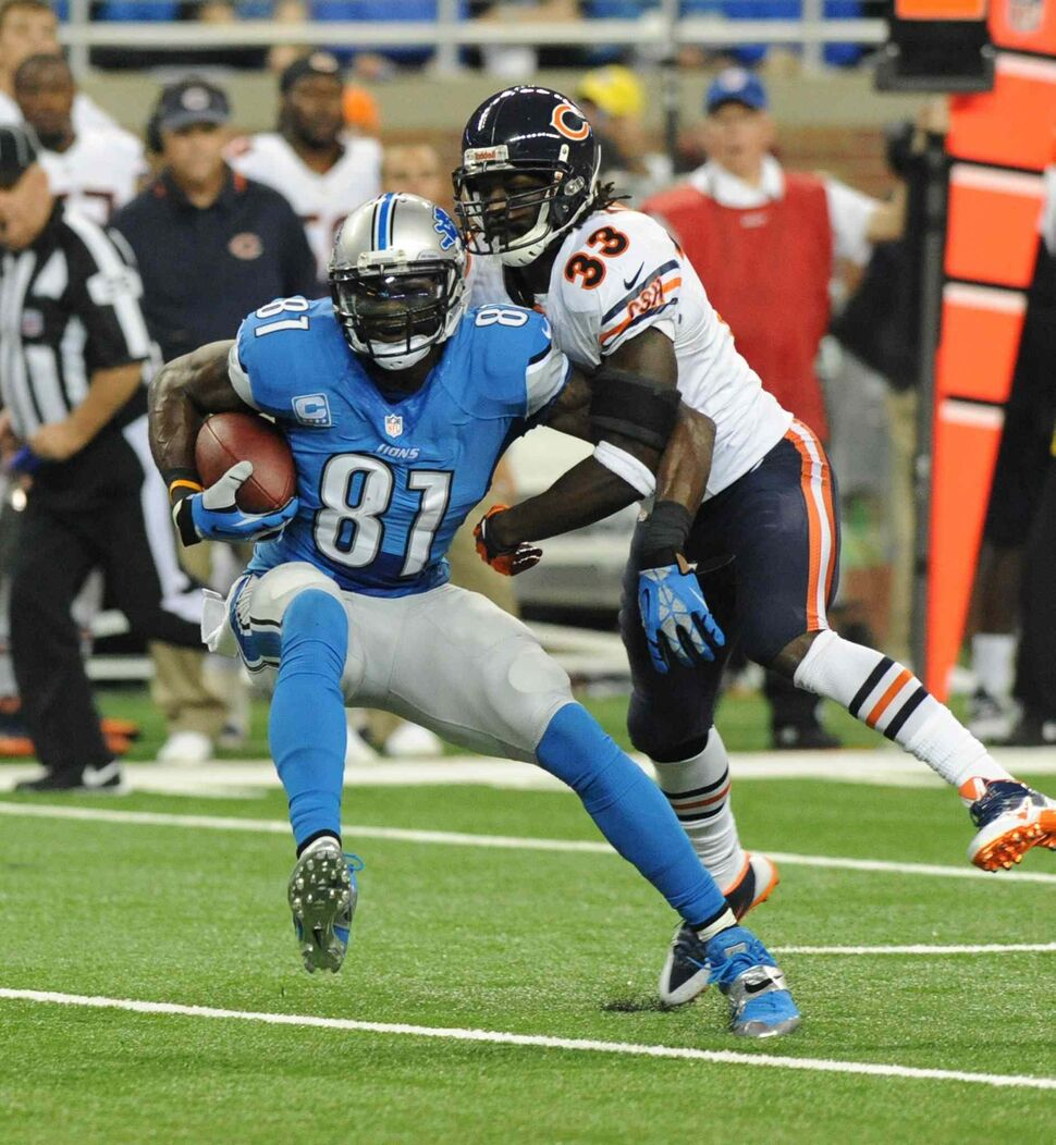Detroit Lions wide receiver Calvin Johnson (left) makes a reception in front of Chicago Bears cornerback Charles Tillman during the first quarter of the Lions' 40-32 win at Ford Field in Detroit, Sunday. (Jose Juarez / The Associated Press)