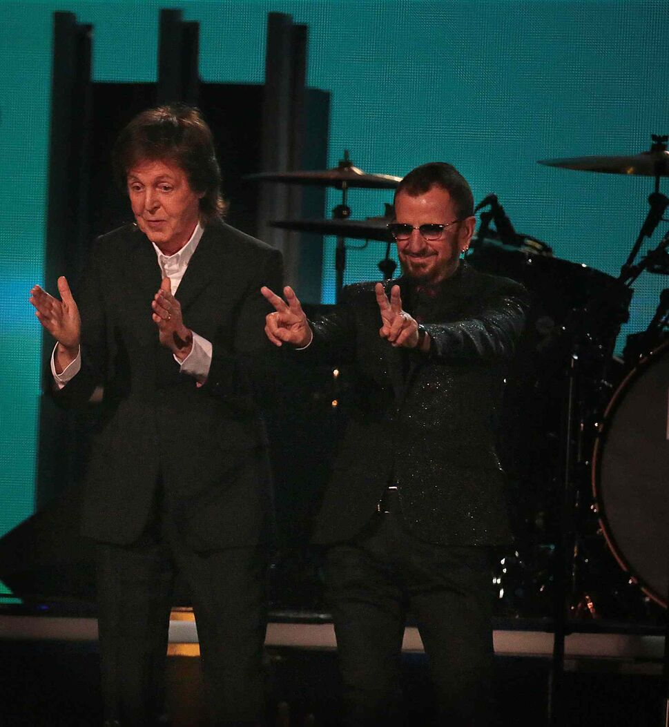 Paul McCartney and Ringo Starr take a bow at the 56th Annual Grammy Awards. (Robert Gauthier / Los Angeles Times / MCT)