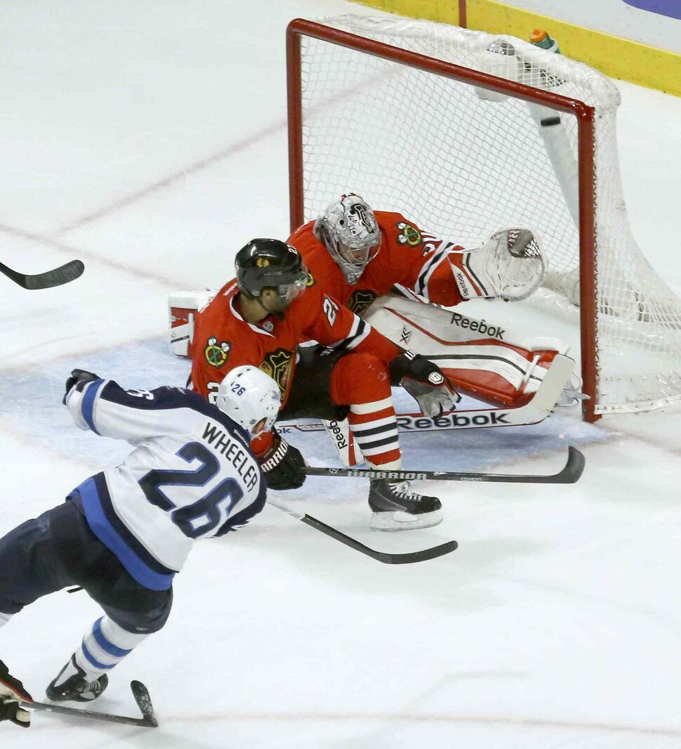 Blake Wheeler opened the scoring for the Jets in the third period. (Charles Rex Arbogast / The Associated Press)
