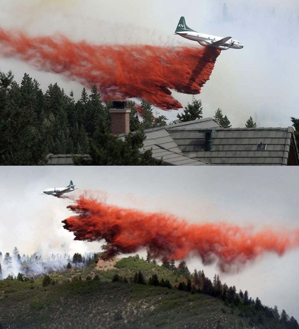 (top) A tanker drops fire retardant while fighting the Flagstaff wildfire on Tuesday, June 26, 2012 in Boulder Colorado. (AP Photo/Jeremy Papasso, Daily Camera)