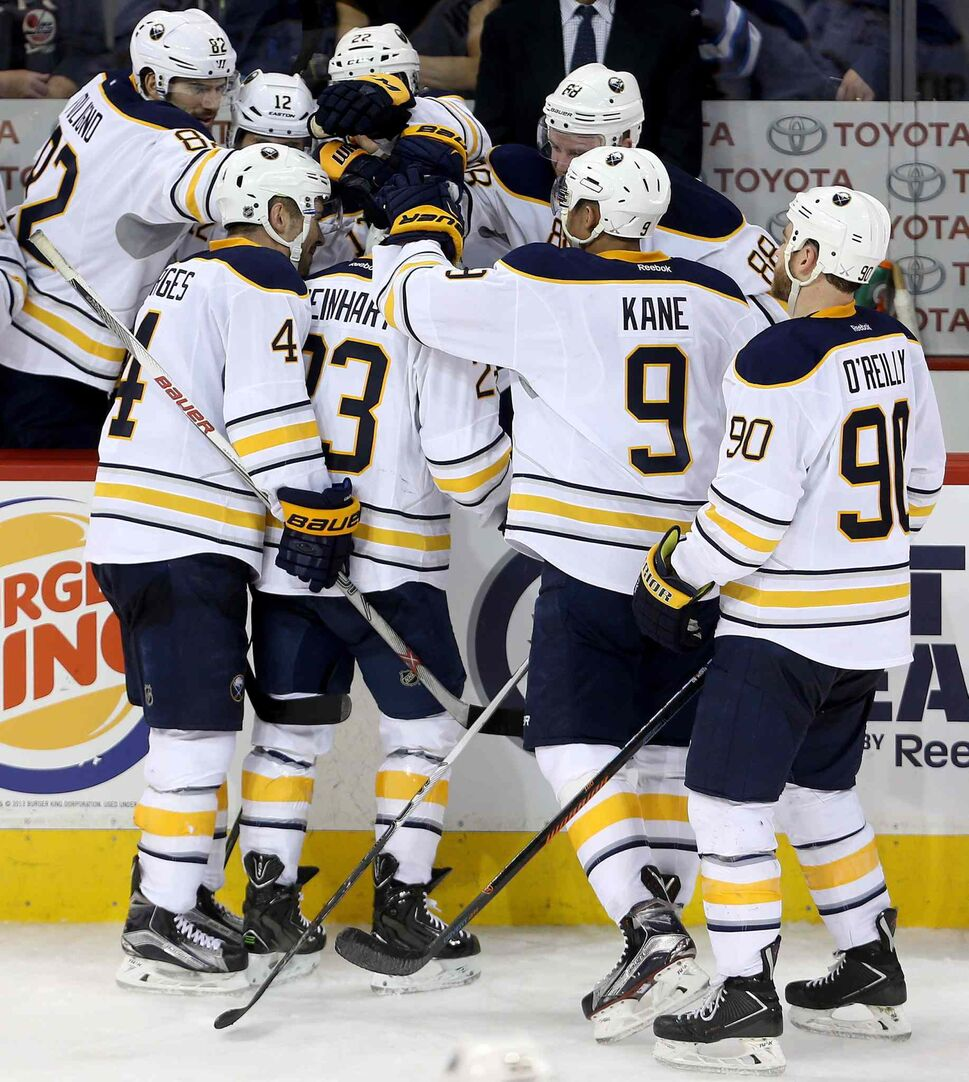 The Buffalo Sabres' bench congratulates Sam Reinhart (23) after he completes a hat trick against the Winnipeg Jets' during third period NHL hockey action in Winnipeg, Sunday, January 10, 2016. THE CANADIAN PRESS/Trevor Hagan (CP)