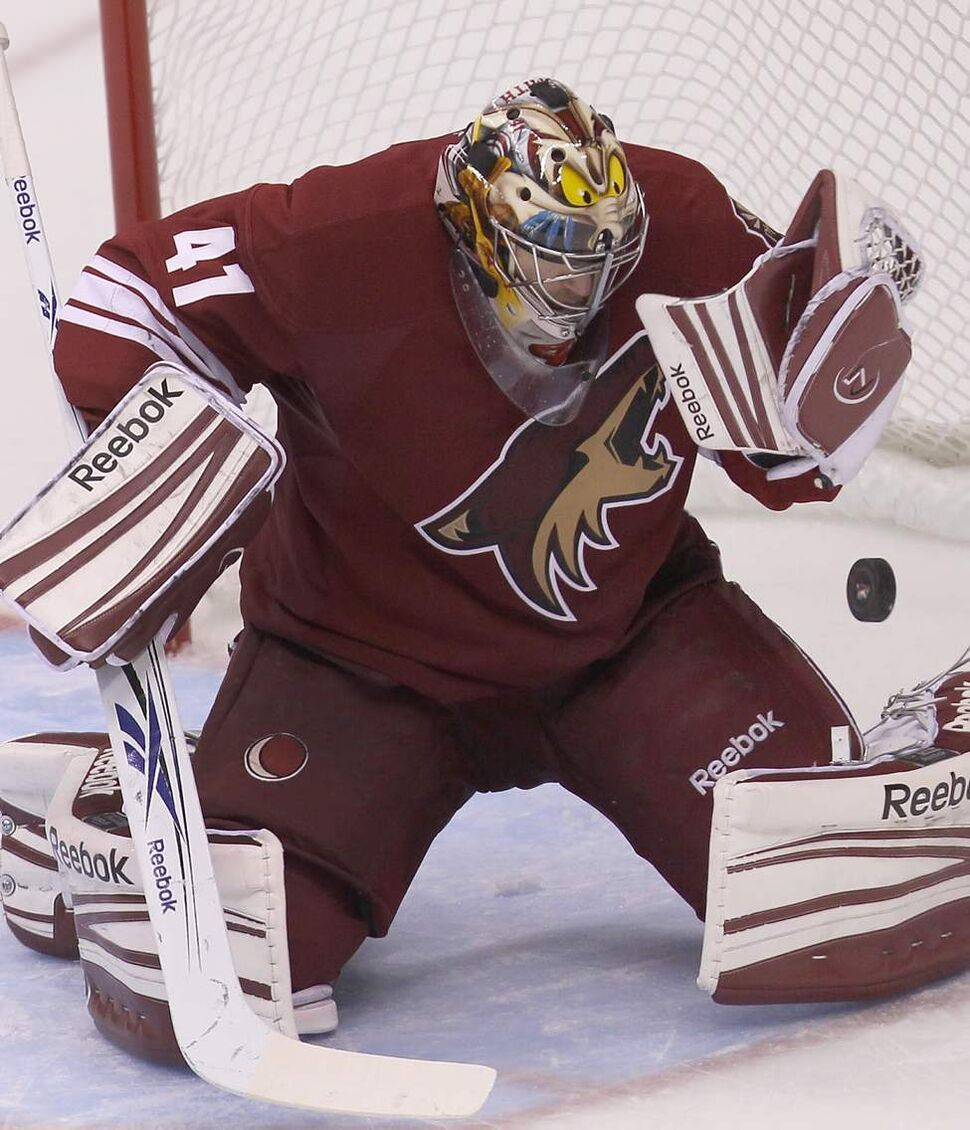 Phoenix Coyotes goaltender Mike Smith keeps his eyes on the puck  during third period action Saturday night at the Jobing.com Arena in Glendale, Arizona against the Winnipeg Jets. The Coyotes beat the Winnipeg Jets 4-1.   (JOE BRYKSA / WINNIPEG FREE PRESS)