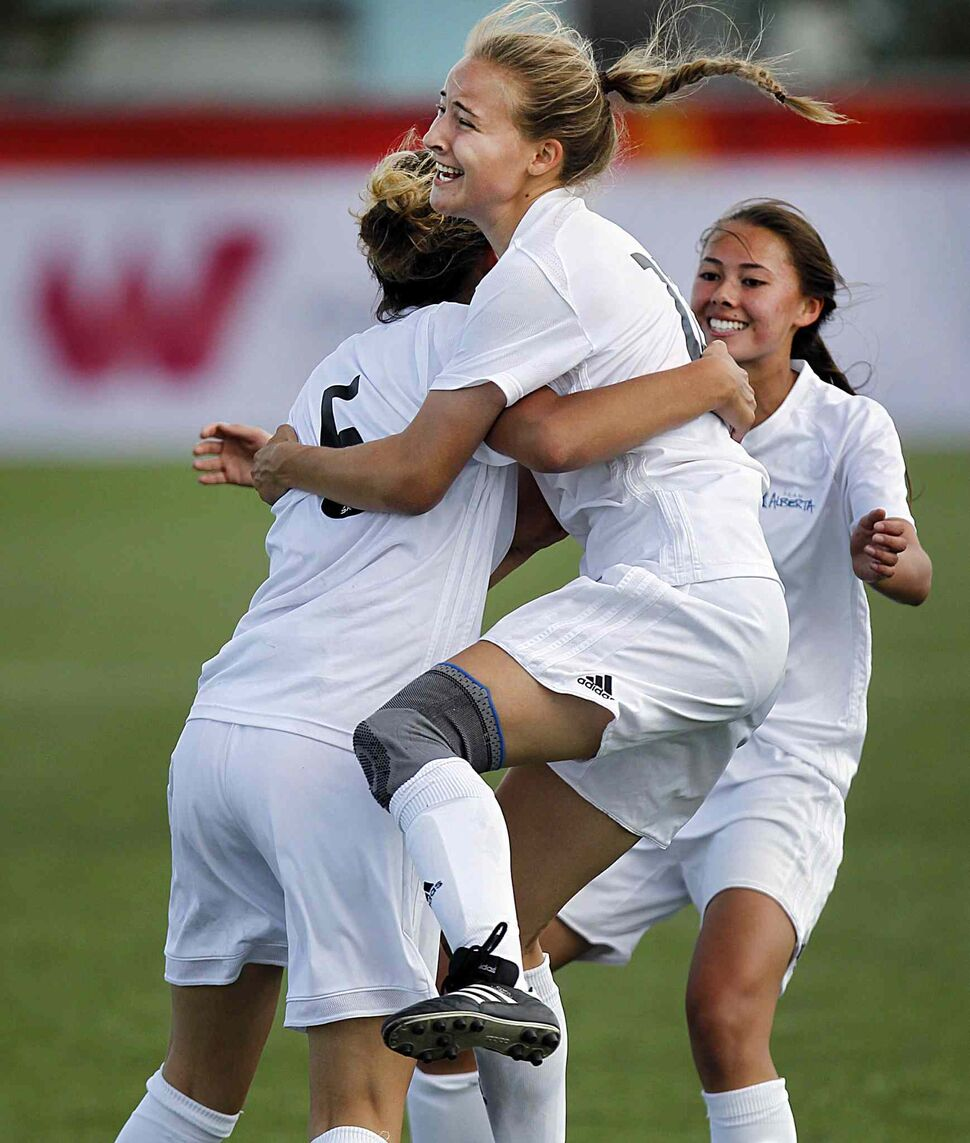 PHIL HOSSACK / WINNIPEG FREE PRESS</p><p>Team Alberta's Aliya Coy (#5) and Hannah Duguid celebrate the team's opening goal against Team Manitoba at the Ralph Cantafio Soccer Complex Tuesday, Aug. 1, 2017. Alberta won with a final score of 2-0.</p>