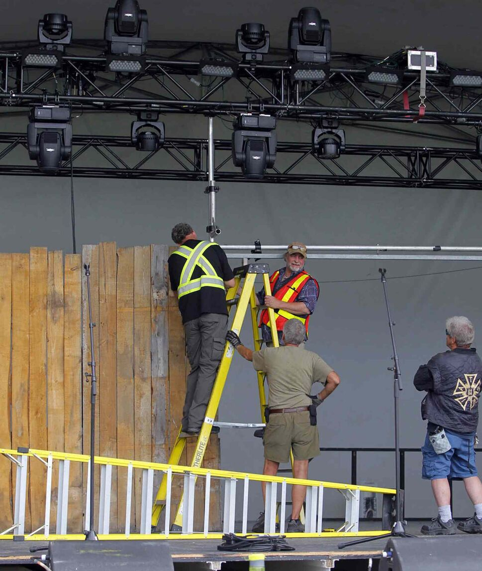 Stage hands set up the festival's Main Stage a day before the festival opens. (BORIS MINKEVICH / WINNIPEG FREE PRESS)
