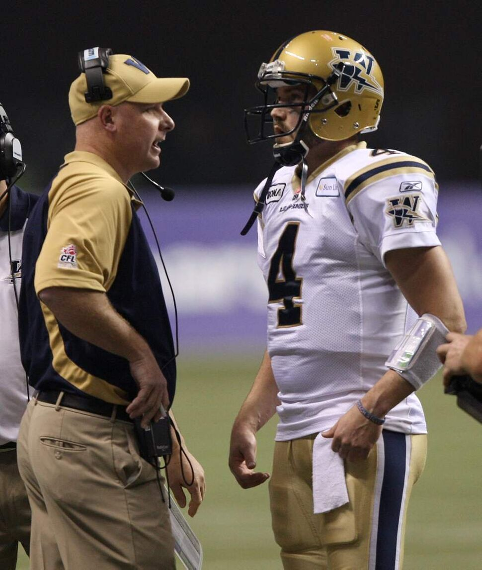 Winnipeg Blue Bombers head coach Paul LaPolice talks to his quarterback Buck Pierce  during second-quarter action. (THE CANADIAN PRESS/Ryan Remiorz)