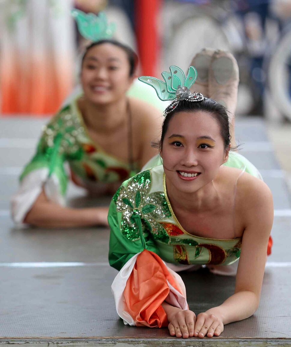 Members of the Great Wall Performing Arts school weren't the only ones smiling during Asian Heritage Month celebrations at The Forks, Sunday. (TREVOR HAGAN / WINNIPEG FREE PRESS)