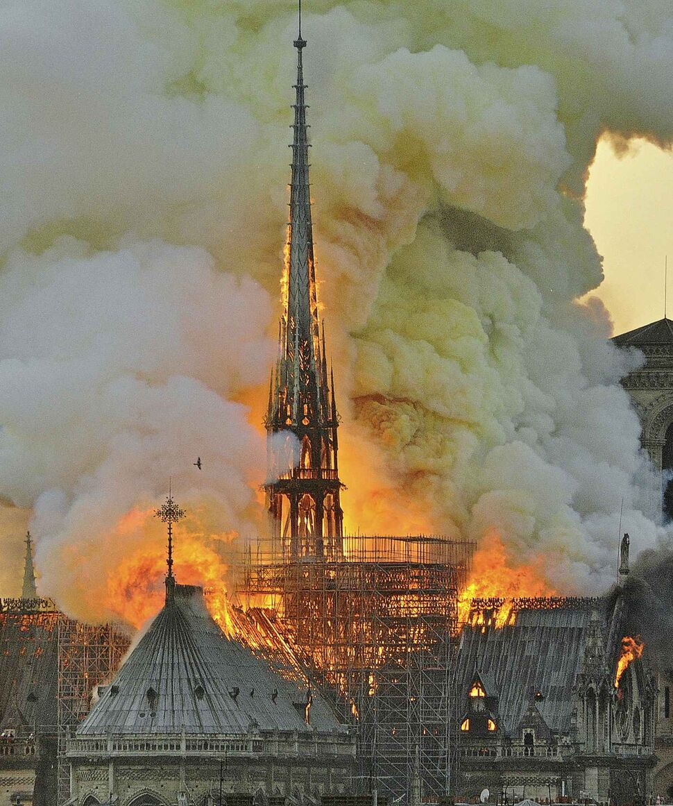 The inferno destroyed Notre Dame's spire and its roof but spared its twin medieval bell towers. (Thierry Mallet  / The Associated Press)