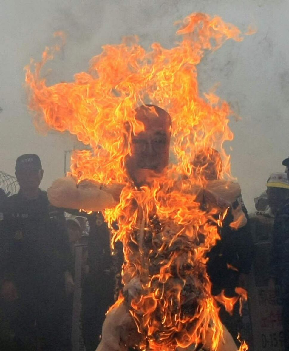 An effigy of pro-North Korean activist No Su-hui is burned by protesters during a rally near the border village of Panmunjom, in Paju. South Korean police arrested No for making an extended trip to Pyongyang without government approval. (AP Photo/Lee Jin-man)