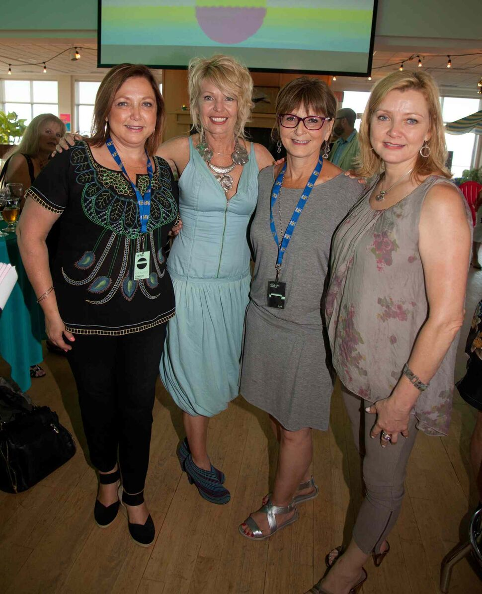 An opening reception for the 15th annual Gimli Film Festival was held Wednesday, July 22, 2015 at the Waterfront Centre. Pictured, from left, are Leslie Ferguson, Lisa Martin, Carol Magnusson and Lisa Magnusson. (JOHN JOHNSTON FOR THE WINNIPEG FREE PRESS)