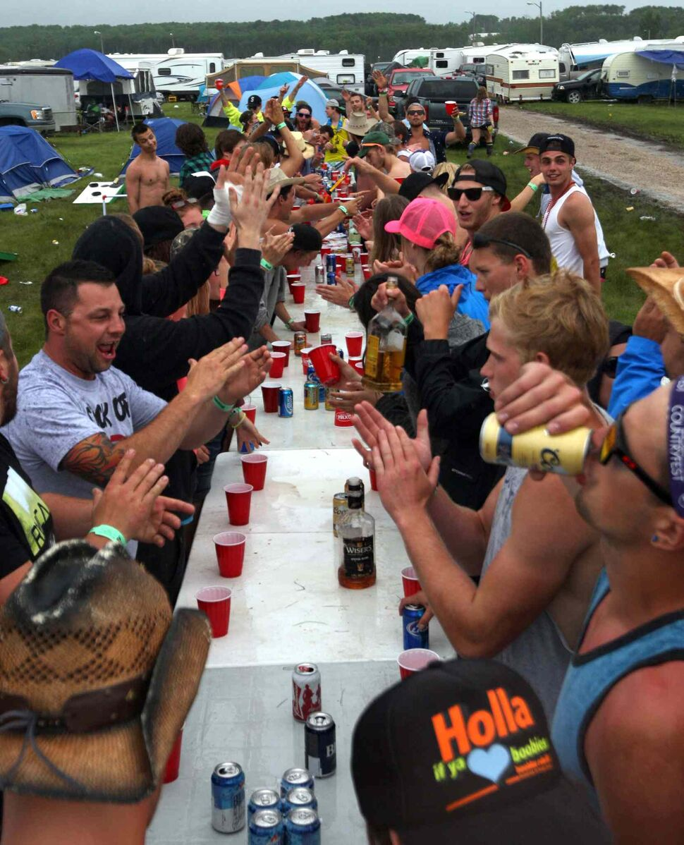 This giant game of flip cup was by far the largest drinking game spotted in the campground. (Boris Minkevich / Winnipeg Free Press)