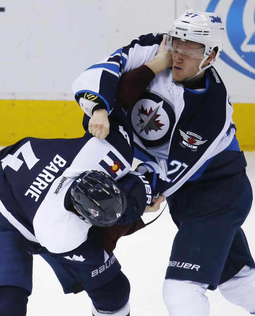 Winnipeg Jets left wing Nikolaj Ehlers, right, fights with Colorado Avalanche defenceman Tyson Barrie during the third period of Saturday's game.   (David Zalubowski / The Associated Press files)