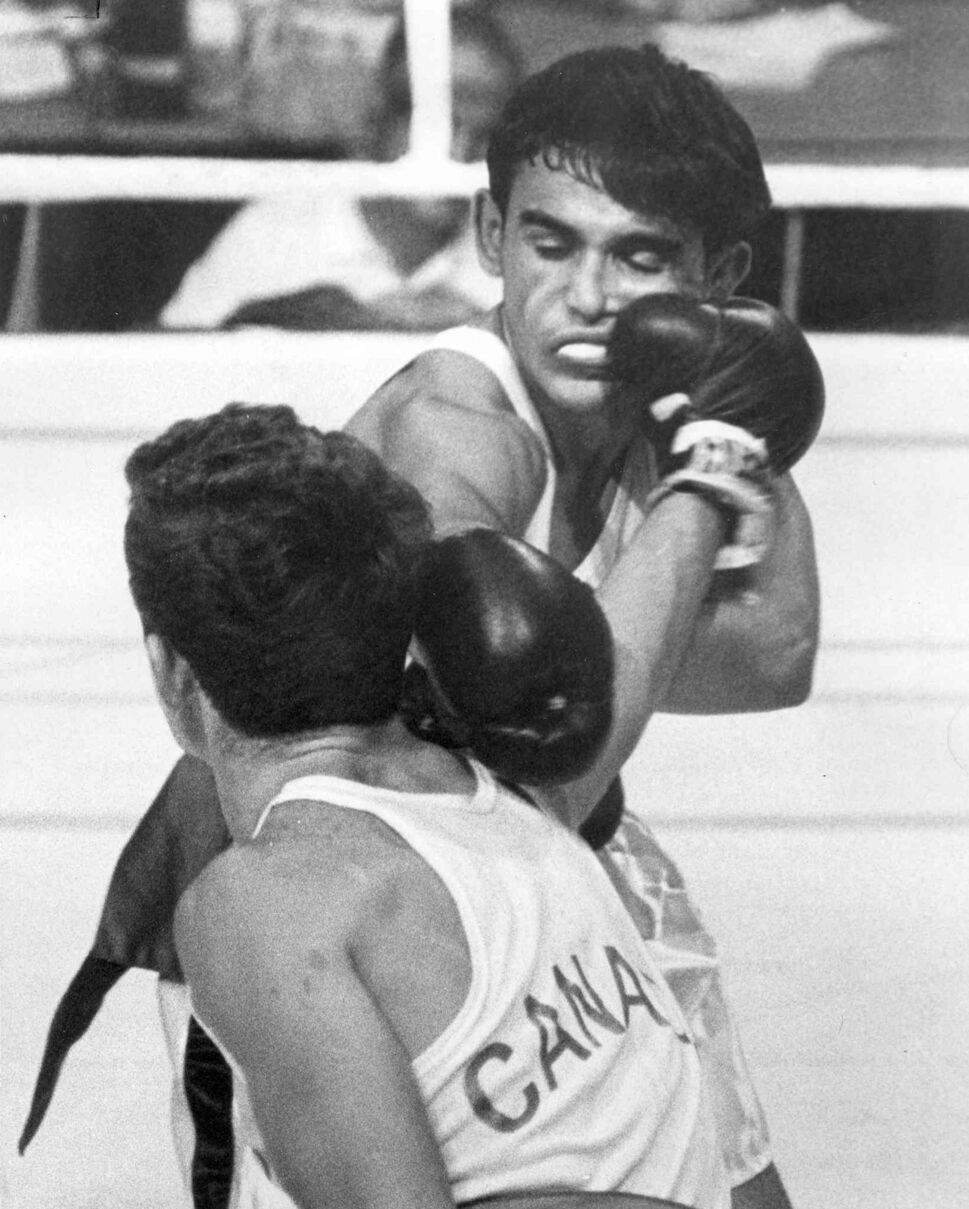 Wayne Boyce (Canada) lands a right to the face of Freytes Caban Ortiz (Puerto Rico) in in a featherweight bout. Ortiz won.   (Winnipeg Fress Press Files)
