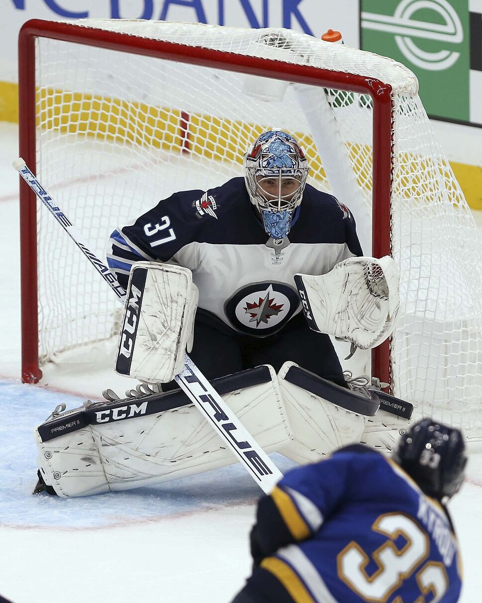 Winnipeg will go with the same lineup as their opener, with Connor Hellebuyck back in net after a 41-save, first-star performance in St. Louis. (Scott Kane / The Associated Press Files)