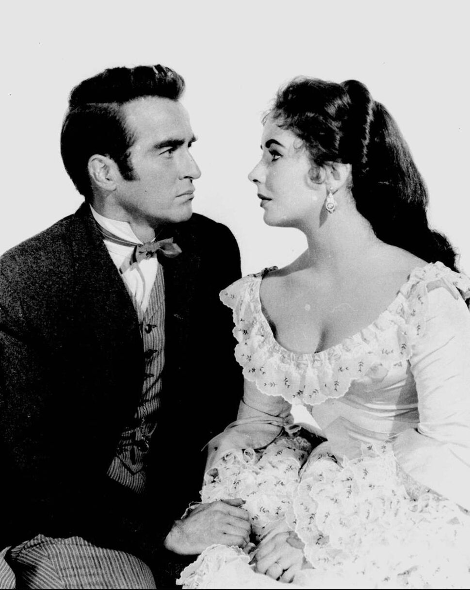 """In this 1957 file photo, Elizabeth Taylor poses with Montgomery Clift for the film """"Raintree County."""" (AP Photo/File)"""