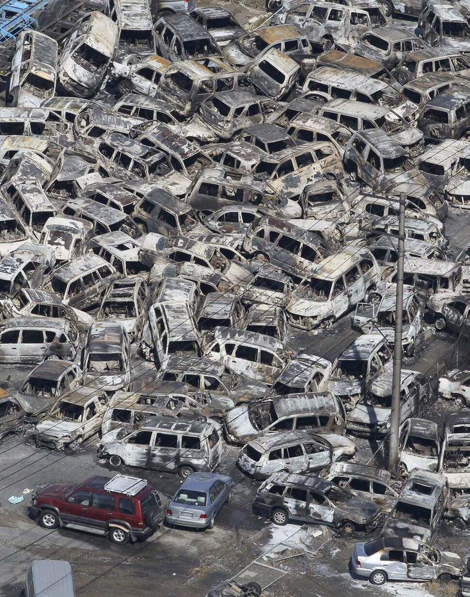 In this photo taken Friday, March 11, 2011, an aerial view shows vehicles washed away by an earthquake triggered tsunami in Hitachinaka, Ibaraki prefecture, Japan. The country's biggest recorded earthquake slammed into its eastern coast Friday. (AP Photo/The Yomiuri Shimbun, Atsushi Taketazu)