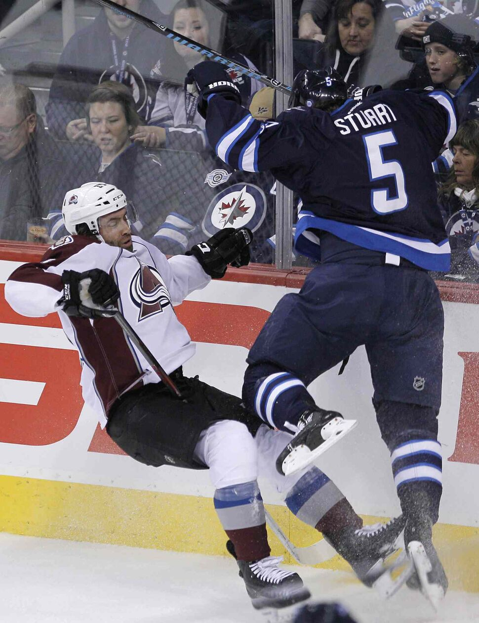 Mark Stuart (right) hits  Maxime Talbot of the Colorado Avalanche during the first period. (JOHN WOODS / THE CANADIAN PRESS)