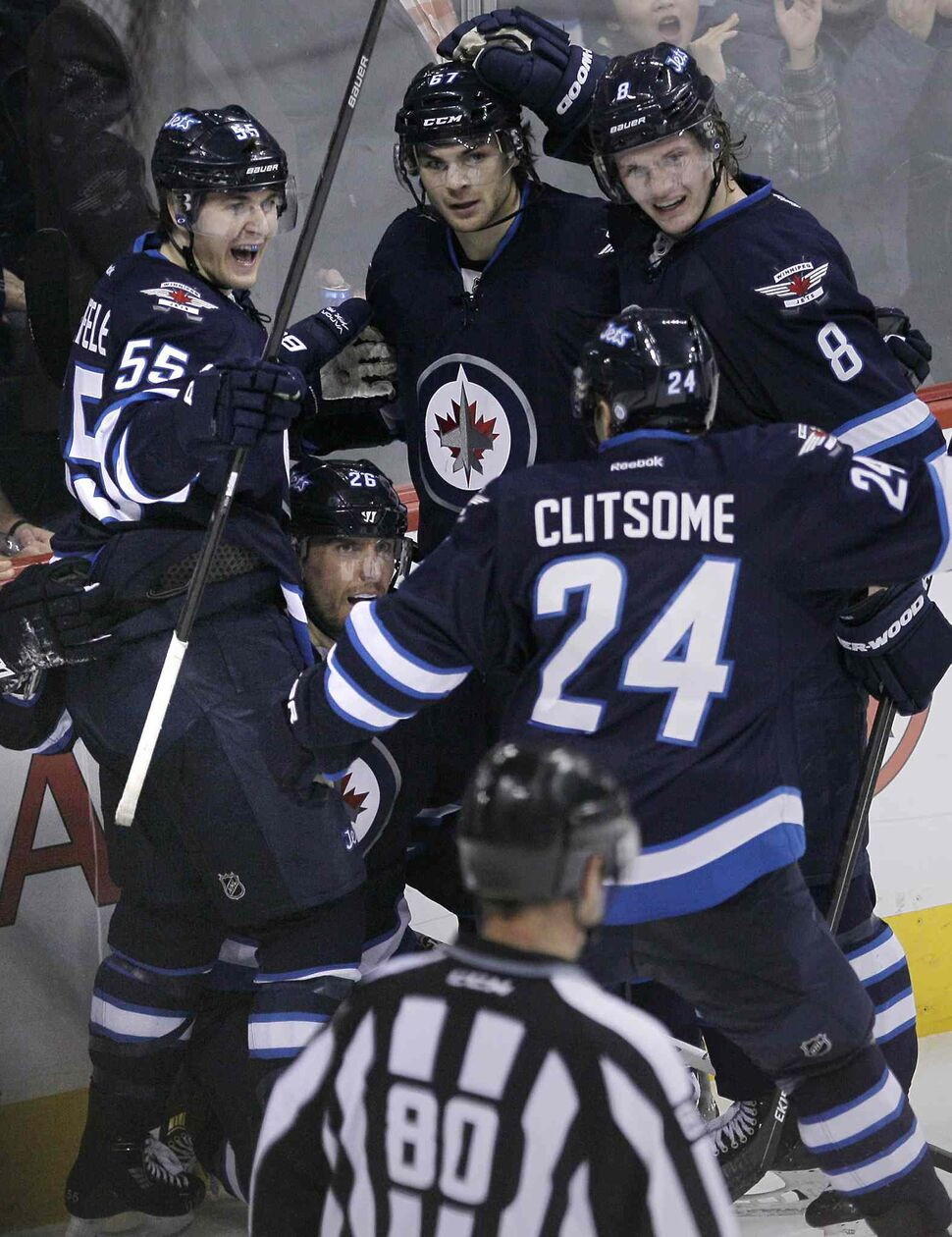 Winnipeg Jets (from left) Mark Scheifele, Blake Wheeler, Michael Frolik, Grant Clitsome and Jacob Trouba celebrate Wheeler's tying goal against the Colorado Avalanche in the third period. (JOHN WOODS / THE CANADIAN PRESS)