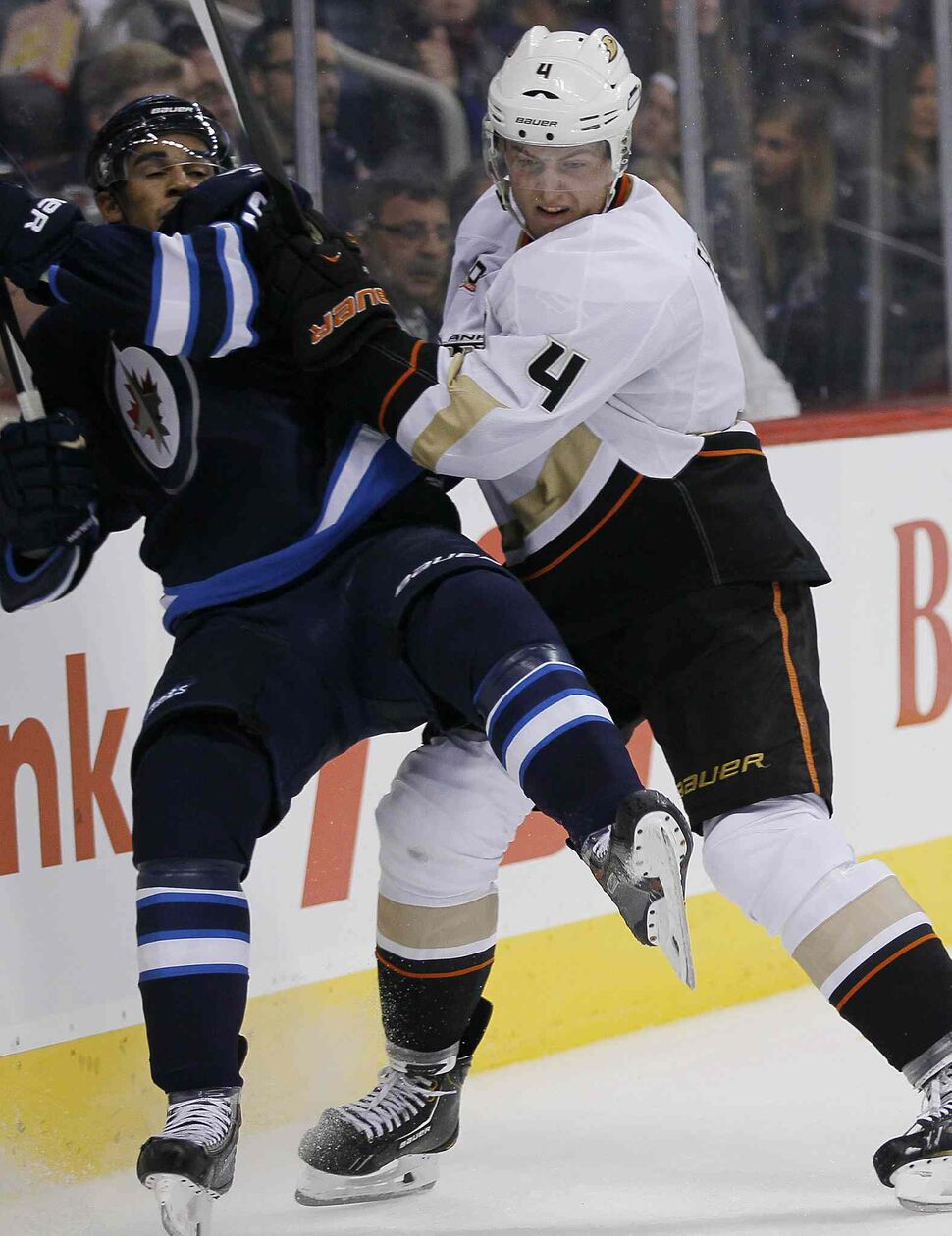 Anaheim Ducks' Cam Fowler takes out Winnipeg Jets' Evander Kane during the second period. (JOHN WOODS / WINNIPEG FREE PRESS)