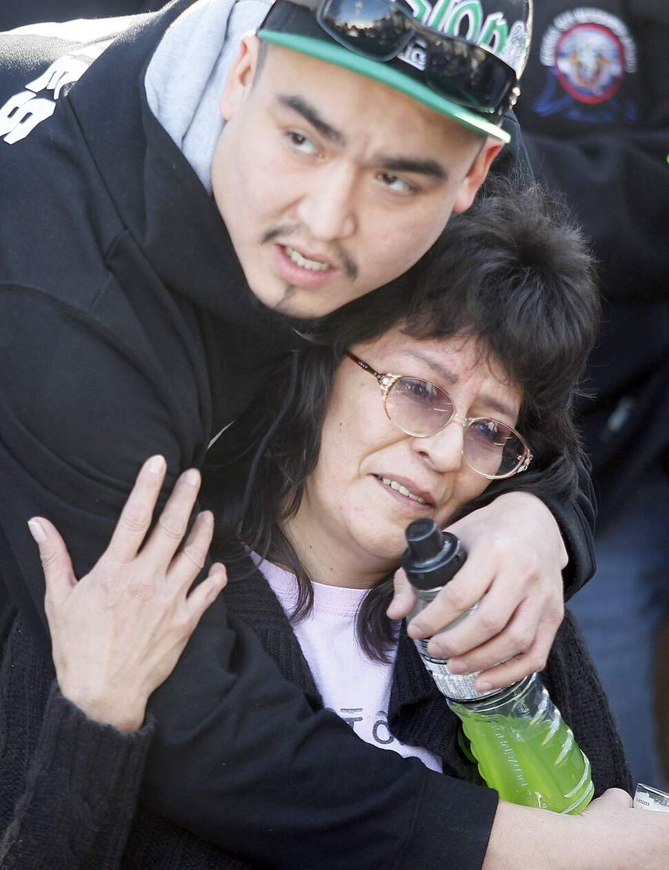 The mother of Carolyn Marie Sinclair is comforted at a vigil Tuesday April 3, 2012 for Carolyn Marie Sinclair and her unborn baby who were found murdered and dumped in a back lane on the 700 block of Notre Dame Avenue Saturday March 31, 2012.  (John Woods / Winnipeg Free Press)