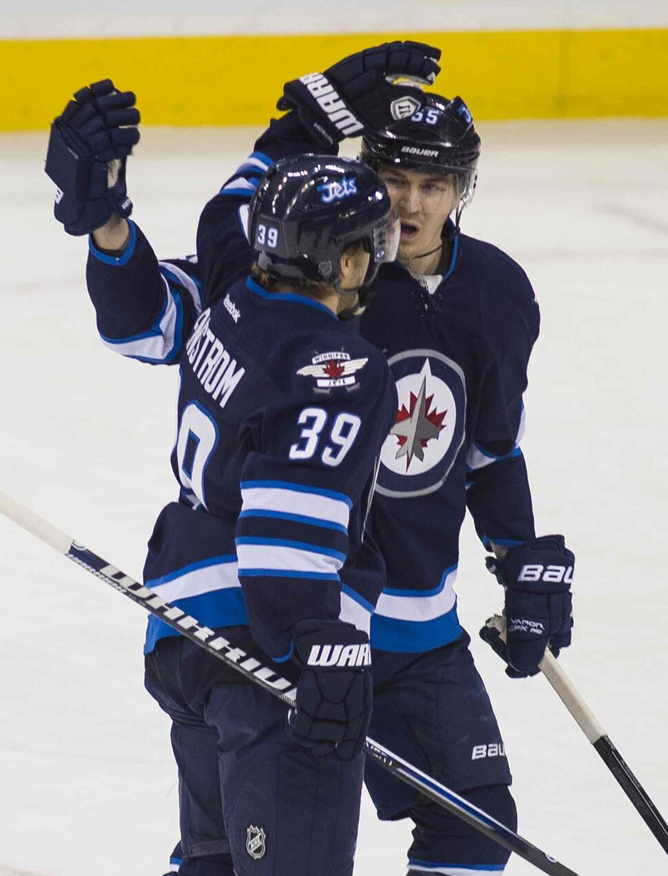 Winnipeg Jets Tobias Enstrom (#39) celebrates his goal during the first period. (DAVID LIPNOWSKI / WINNIPEG FREE PRESS )