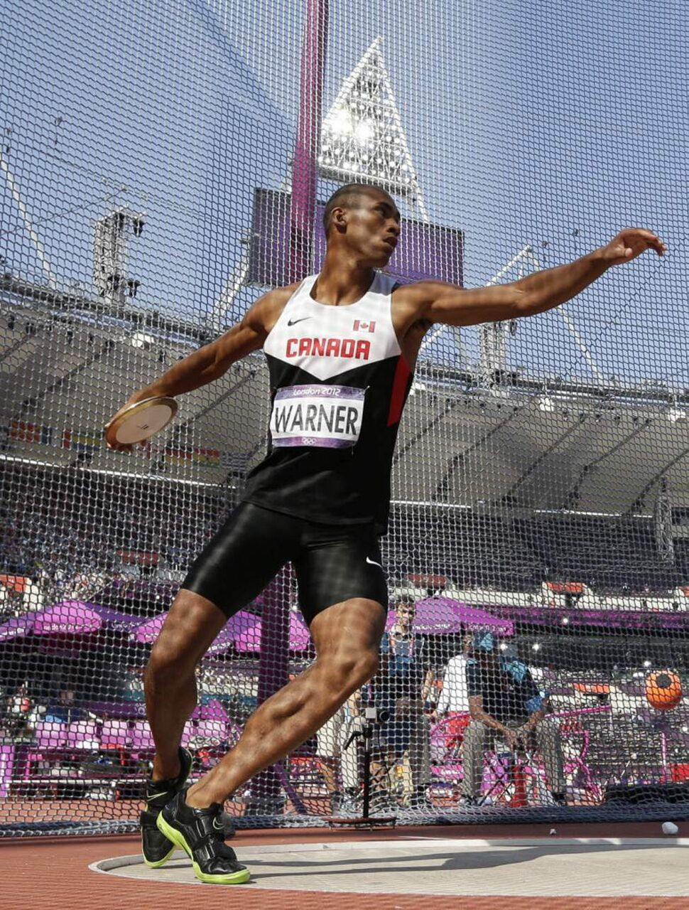 Canada's Damian Warner takes a throw in the discus throw for the decathlon in the Olympic Stadium at the 2012 Summer Olympics. (AP Photo/David J. Phillip)