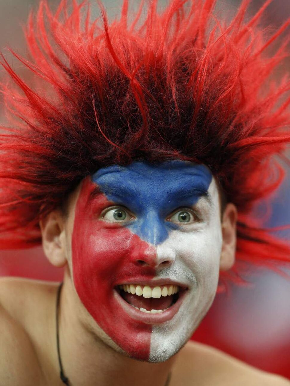 A Czech fan cheers before the Euro 2012 soccer championship quarterfinal match between Czech Republic and Portugal in Warsaw, Poland. (AP Photo/Jon Super)