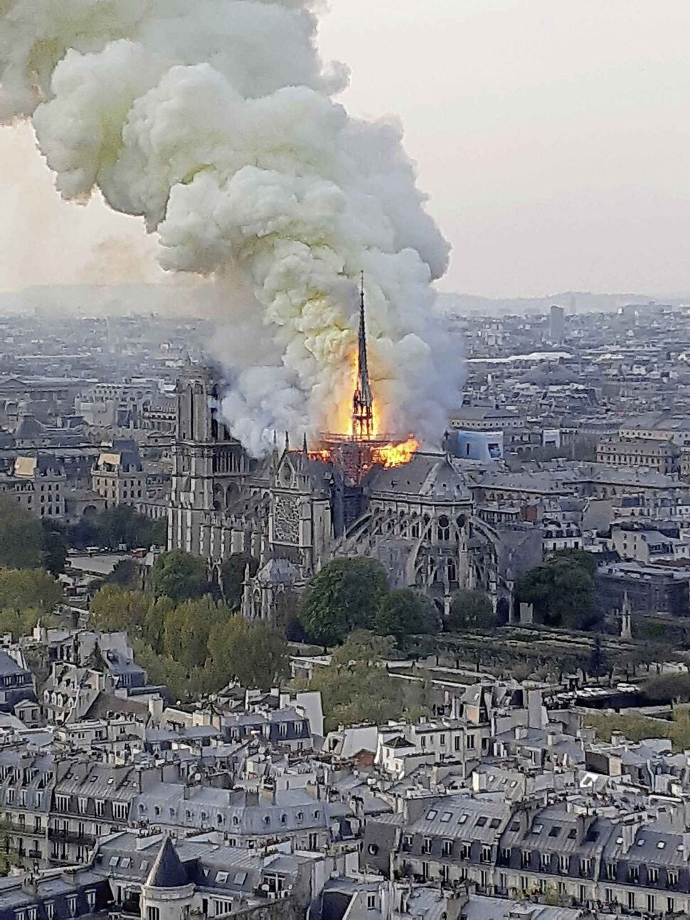 Flames and smoke rise from the blaze at Notre Dame cathedral in Paris, Monday. (Cedric Herpson  / The Associated Press)