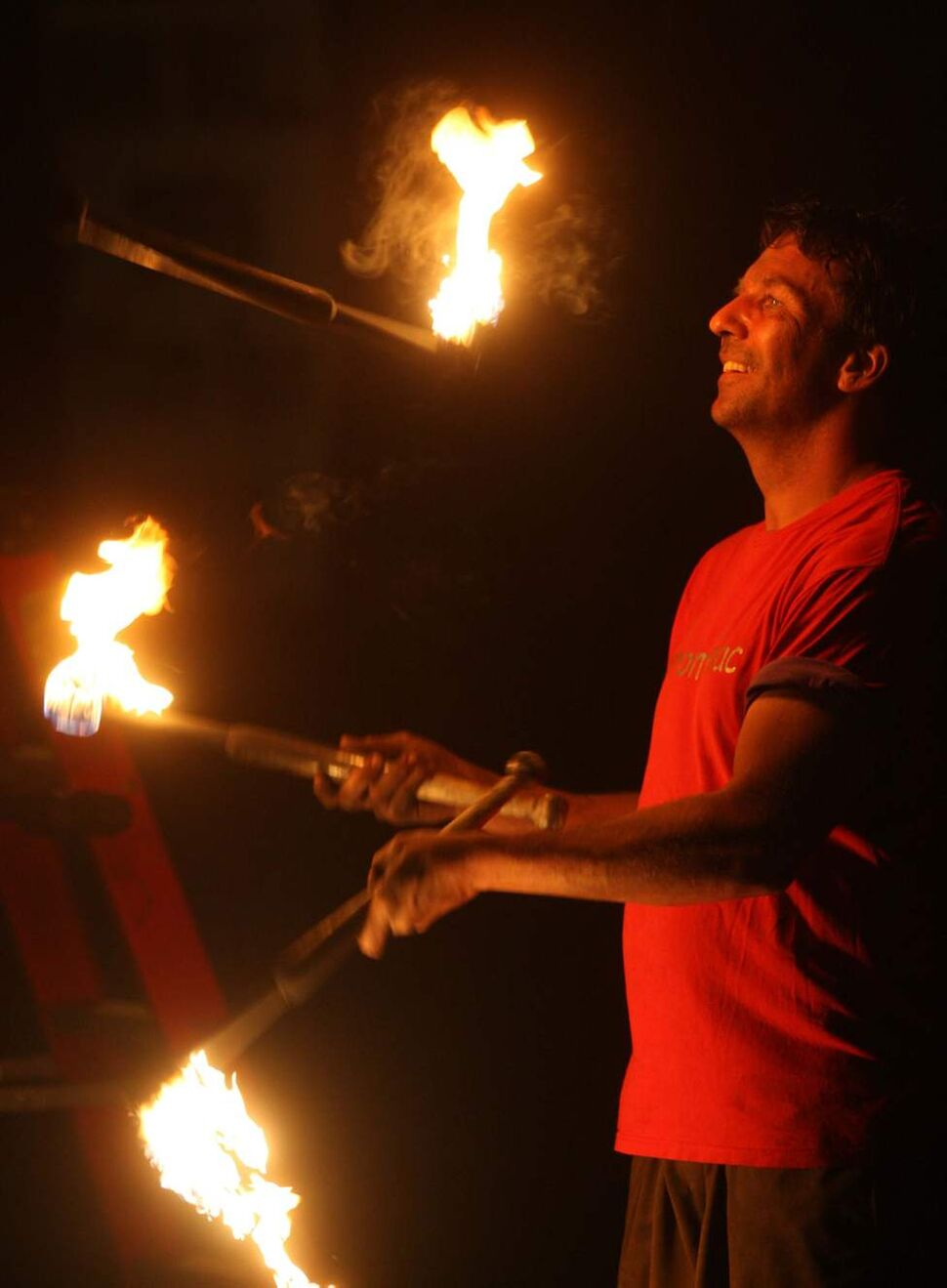 DAUPHIN COUNTRYFEST - Festival sideshow entertainer juggles fire.   June 27, 2014