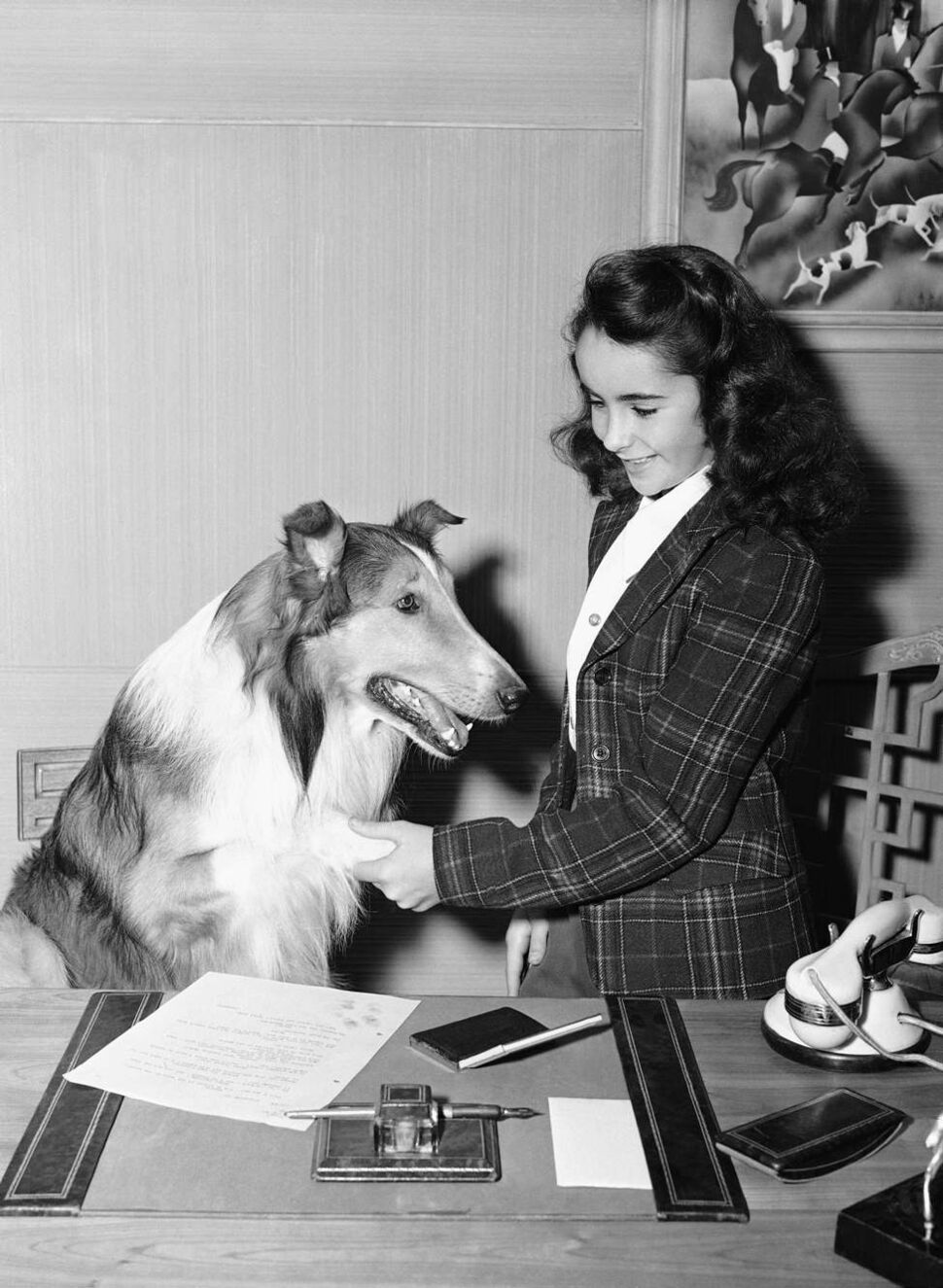"""In this 1943 file photo, 11- year-old Elizabeth Taylor is shown with Lassie around the time of her performance in """"Lassie Comes Home"""" in Los Angeles. (AP Photo/File)"""