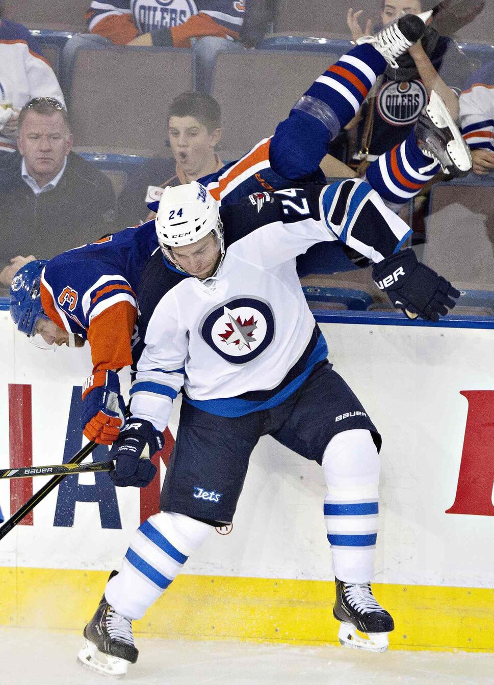 Winnipeg Jets defenceman Grant Clitsome checks Edmonton Oilers Linus Omark during the third period. (Jason Franson / The Canadian Press)
