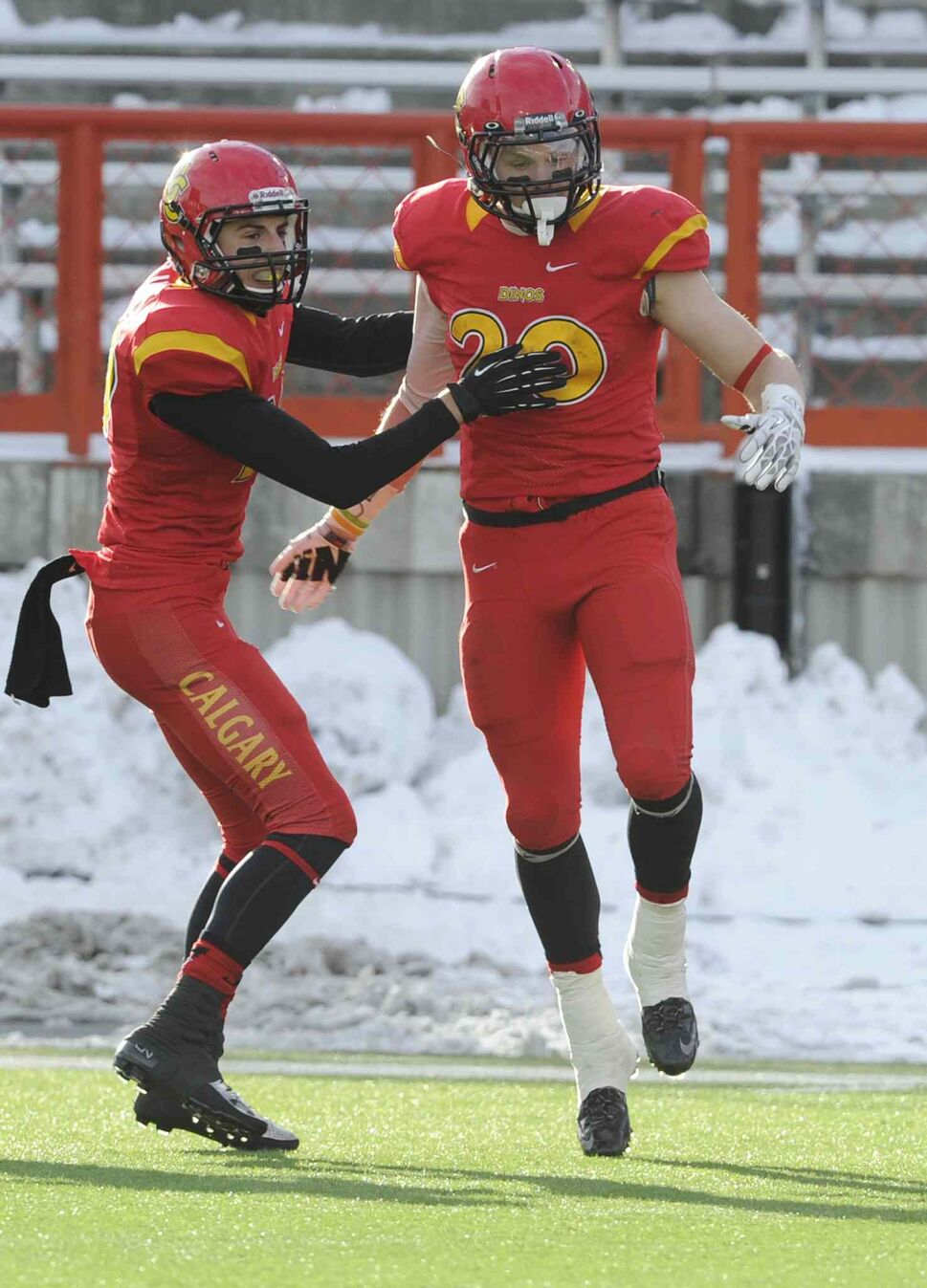 Calgary Dinos' Mercer Timmis (right) celebrates his touchdown against the Bisons with Michael Klukas in the first half. (Larry MacDougal / The Canadian Press)