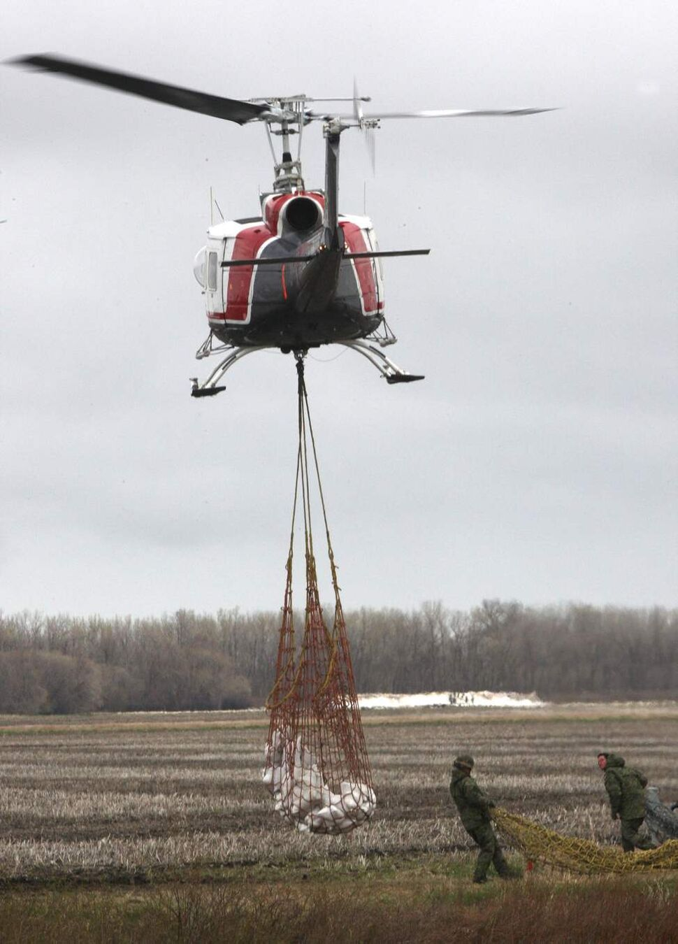 Helicopters one after another arive at a location north of Oakville, Manitoba to ferry sandbags to dike location on the Assiniboine River Thursday.  May 12, 2011. (Joe Bryksa / Winnipeg Free Press)