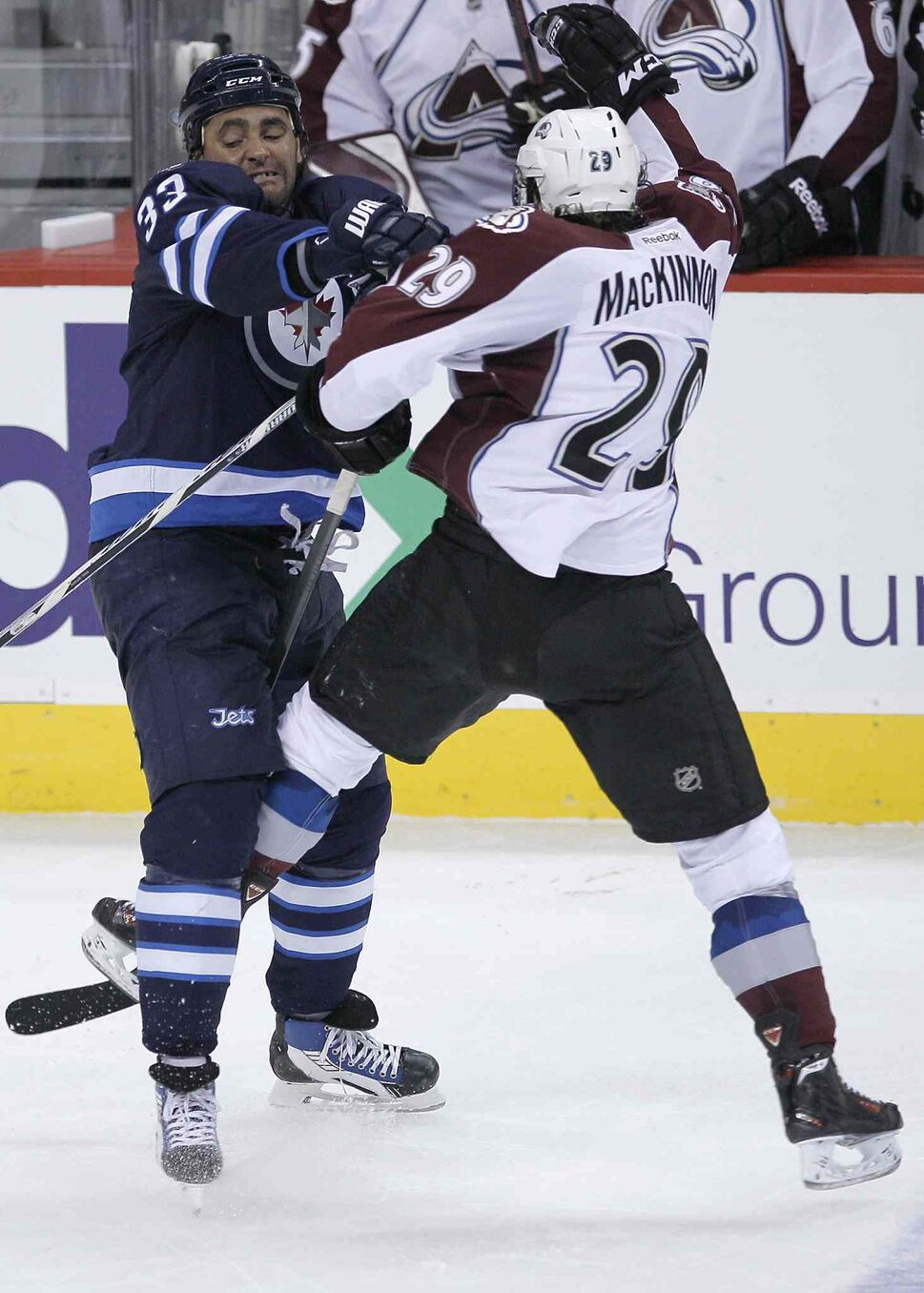 Winnipeg Jets' Dustin Byfuglien (left) and Colorado Avalanche's Nathan MacKinnon collide in the third period. (JOHN WOODS / THE CANADIAN PRESS)