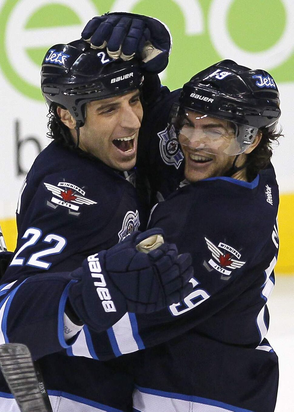 Winnipeg Jets' Chris Thorburn (22), and Jim Slater (19) celebrate Thorburn's goal against the Buffalo Sabres during third period NHL action in Winnipeg on March 5, 2012. (John Woods / The Winnipeg Free Press)